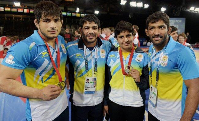 Indian wrestlers (L-R) Pawan Kumar, Sushil Kumar, Geetika and Yogeshwar Dutt medals at the...