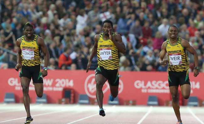 Rasheed Dwyer, centre of Jamaica, leads home a Jamaica 1, 2, 3, with Warren Weir, right, who...