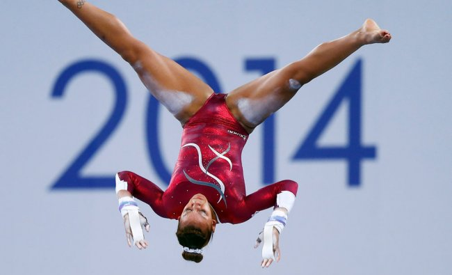 Rebecca Downie of England performs during the women\'s gymnastics uneven bars apparatus final at...