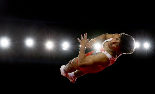 Ashish Kumar of India performs during the men\'s individual floor exercise final in the artistic...