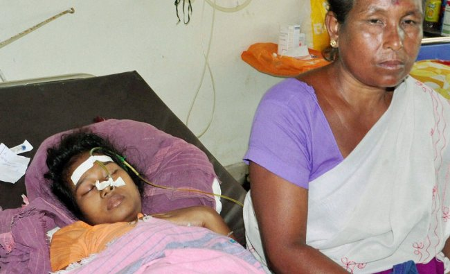 Patients suffering with Japanese encephalitis being treated at the Gauhati Medical College ...