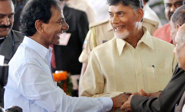 Telangana CM K Chandra Sekhar Rao and AP CM N Chandrababu Naidu shake hands ...