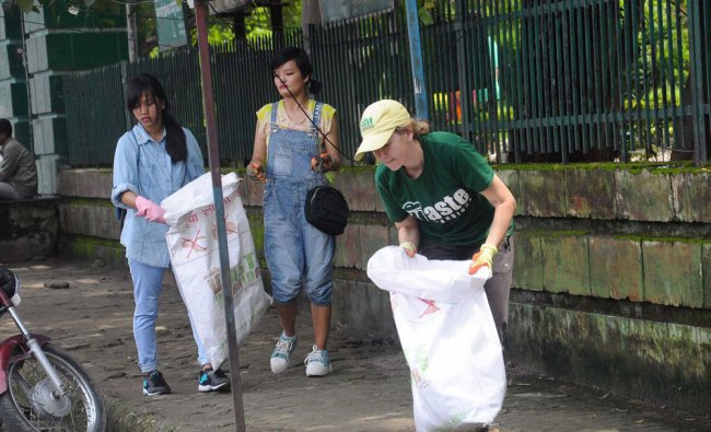 Waste Warriors Co-founder and CEO Jodie Underhill with Bhutanese girls at a cleaning operation ...