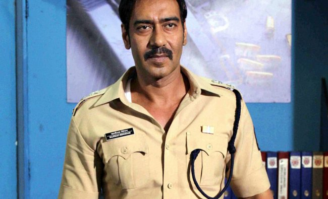 Ajay Devgn on the sets of a TV show to promote his upcoming film Singham Returns in Mumbai ...