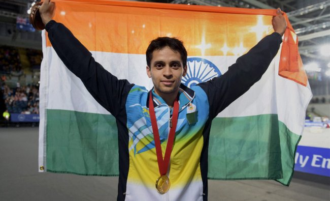 Kashyap Parupalli with his gold medal after the medal ceremony for the Men\'s Single Badminton ...