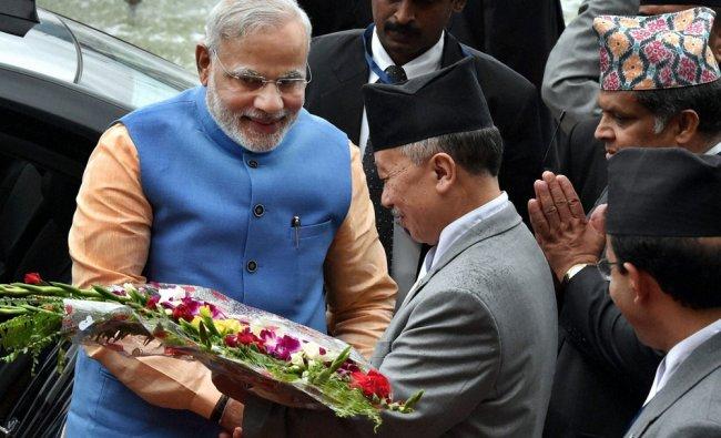 Narendra Modi being welcomed by Subhash Chandra Nembang, Speaker of Parliament in Nepal...