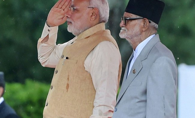Narendra Modi with his Nepali counterpart Sushil Koirala during his official see-off ceremony ...