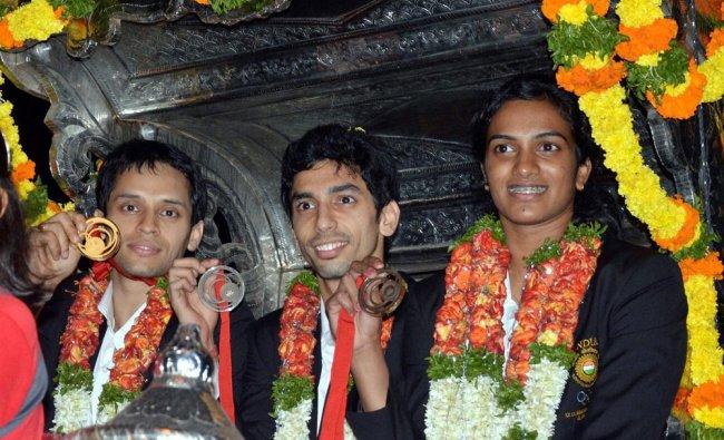 Kashyap Parupalli, Gurusaidutt and P.V.Sindhu arrive at the Gopichand Academy in Hyderabad ...