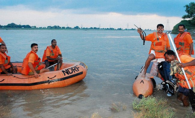 NDRF personnel carry out rescue work after a boat capsizes in Mirzapur ...