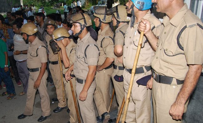 Policemen stand outside Roorkee jail after a shootout between two criminal gangs ...