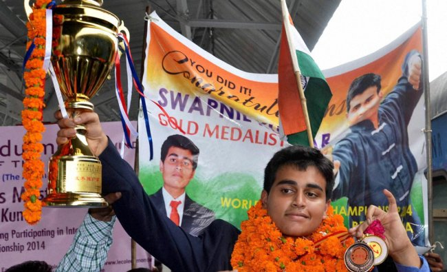 Swapnil Kumar is welcomed on his arrival at Charbagh Railway Station in Lucknow ...