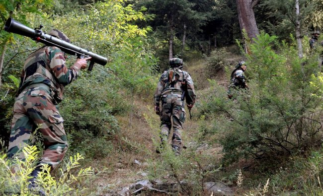 Army soldiers during a massive search operation against militants near the Line of Control ...