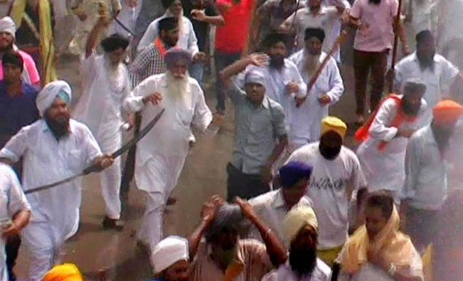 Supporters of the Haryana Shiromani Gurdwara Prabandhak Committee at a protest ...