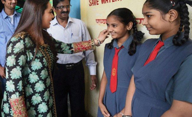 Bollywood actress Rani Mukherji interacts with school girls in Mumbai ...