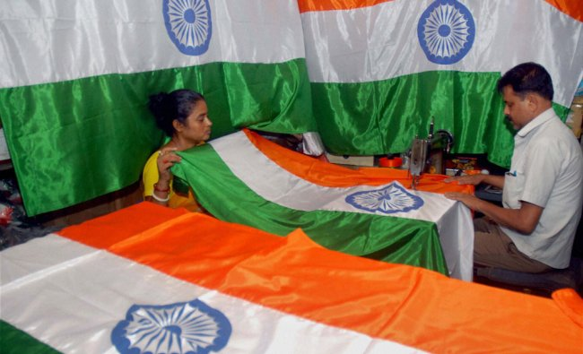 A tailor stitching the Indian National flag ahead of Independence Day at a shop in Kolkata ...