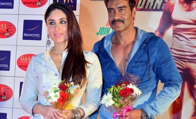 Kareena Kapoor and Ajay Devgn pose during a promotional event of their film \'Singham Returns\' ...