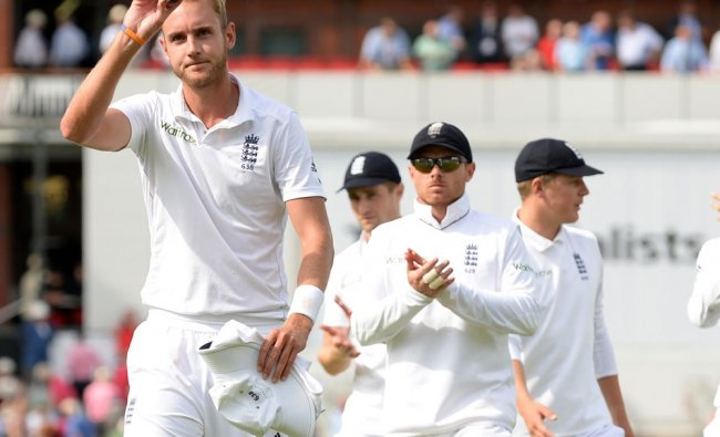 England\'s Broad holds the ball as he leaves the field after taking six wickets against India ...