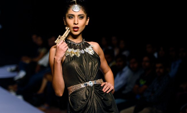 A model displays a creation by Shivali Singh at the Bangalore Fashion Week in Bangalore ...