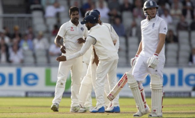 India\'s Varun Aaron, left, celebrates after taking the wicket of England\'s Gary Ballance...