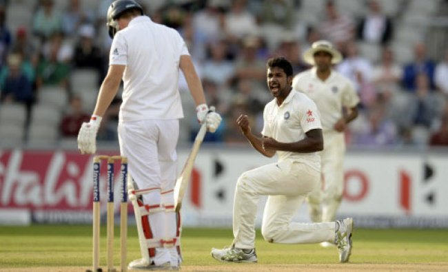 England\'s Varun Aaron celebrates after dismissing England\'s Gary Ballance (L) during the...