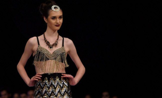 A Model on the ramp to showcase the creation of designer Shivali Singh during the fist day...