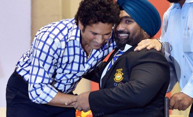 Sachin Tendulkar honors silver medal winner para-lifter Rajinder Rahelu at a felicitation program ..