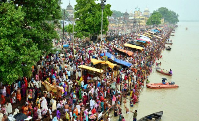 Devotees on the bank of River Saryu taking a dip on the last day of the Hindu month...
