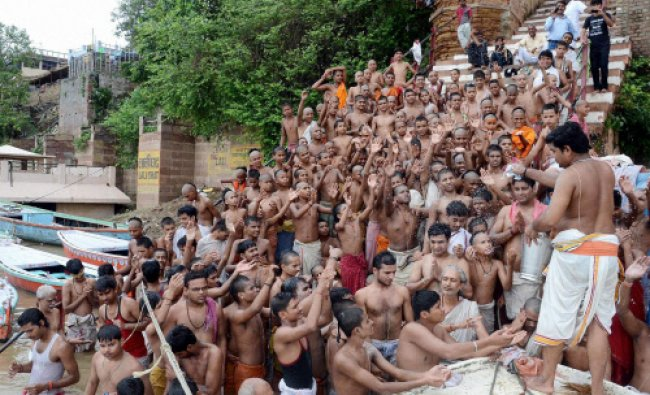 Devotees perform rituals, Shrawani Upakarma, at a ghat on the last day of the Hindu...