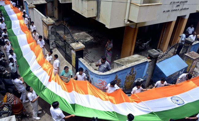 School students hold a 200-meter-long Indian national flag during India\'s Independence Day...