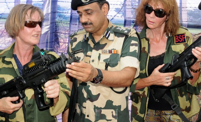 Foreign visitors at Attari land border watching BSFs weaponry put on display to commemorate...
