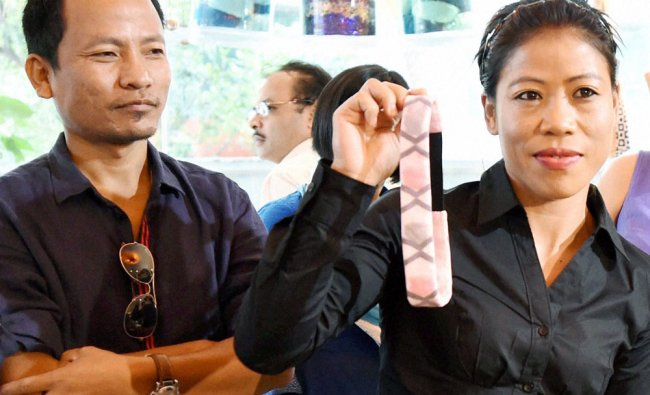 Boxer Mary Kom with husband Onler Karong during a promotional event in Mumbai on Wednesday...