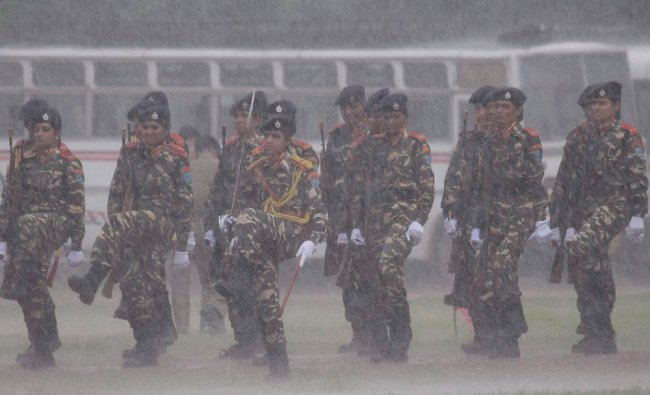 Security personnel during the full dress rehearsal of Independence Day function amidst heavy rain...