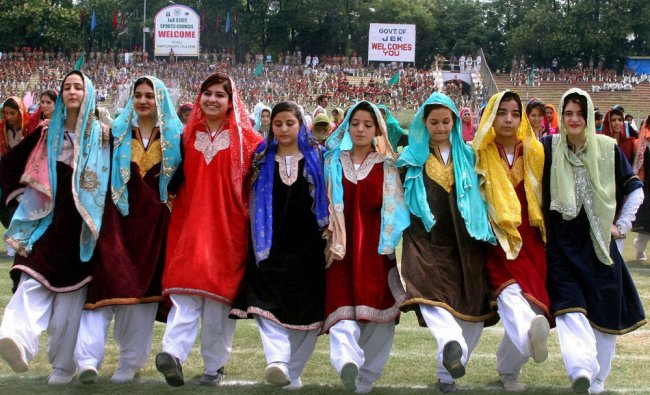 College girls in traditional Kashmiri dresses perform during the full dress rehearsal of...