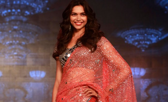 Bollywood actress Deepika Padukone walks the ramp during a promotional event for her upcoming...
