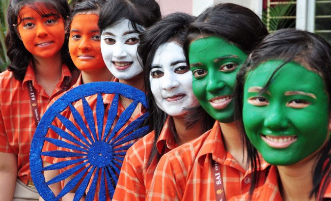 School students paint their faces with tri-colours on the eve of Independence Day in Bhubaneswar...