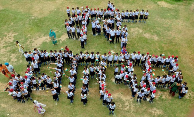 School children making a human chain that reads \'Vande Mataram\' at a School in Patiala on the eve...