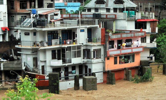 A flooded locality after heavy rains in Mandi, Himachal Pradesh on Thursday...