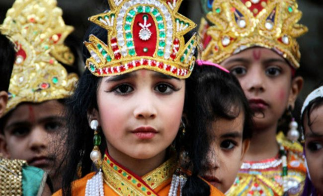 Kids dressed as Lord Krishna as they participate in a procession ahead of Janmashtami...
