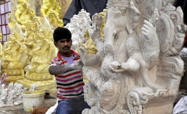 A man preparing idols of Lord Ganesh ahead of Ganesh Chaturthi in Beawar...
