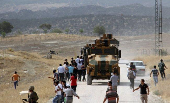 People stone Turkish military vehicles outside Lice, Diyarbakir, Turkey...