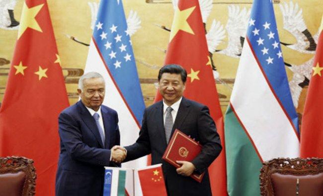 Uzbekistan\'s President Islam Karimov and his Chinese counterpart Xi Jinping...