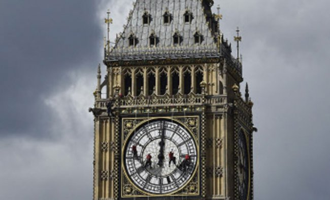 Cleaners abseil down one of the faces of Big Ben, to clean and polish the clock face....