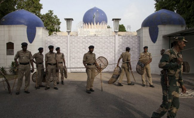 Indian policemen guard outside the Pakistan High Commission as Kashmiri separatist leaders arrive...