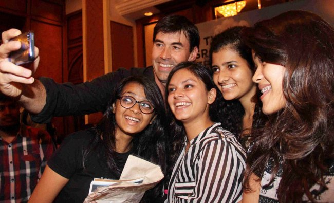 Former New Zealand Captain Stephen Fleming taking a selfie with female fans in Mumbai ...