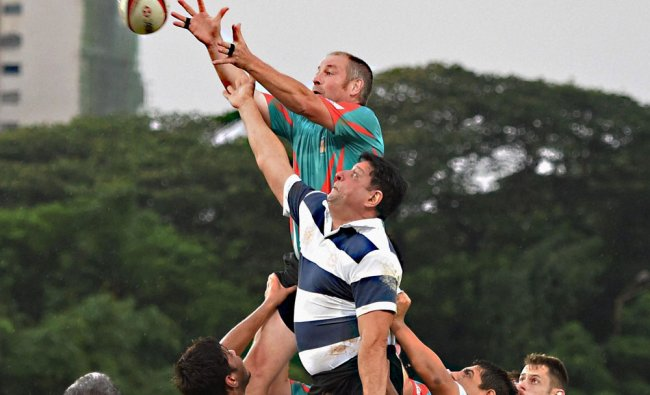 British Parliamentarians (green) during a friendly rugby match with Indian players in Mumbai ...