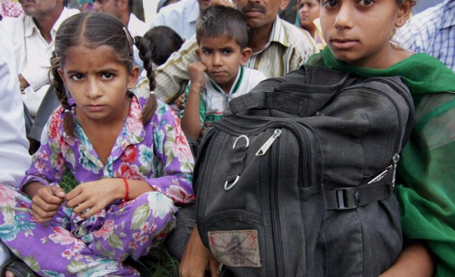 Villagers take shelter at a government school in Rangpur Maulanian, near India Pakistan border ...
