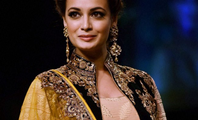 Bollywood actress Dia Mirza walks the ramp, displaying the collection of designer Vikram Phadnis ...