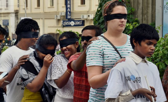 Visually Impaired youngsters with volunteers take part in a \'Blind Walk\' in Bengaluru ...