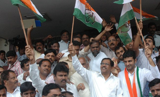 Congress Workers celebrate their victory at K P CC Office in Bangalore ...