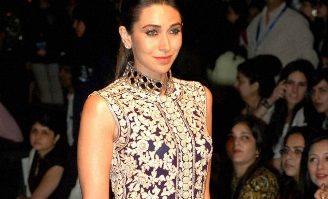 Karishma Kapoor walks the ramp at the Lakme Fashion Week in Mumbai ...